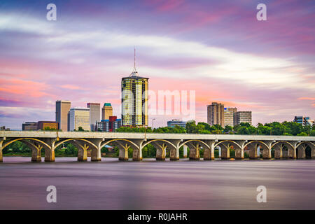 Tulsa, Oklahoma, USA downtown skyline on the Arkansas River at dusk. - Stock Photo