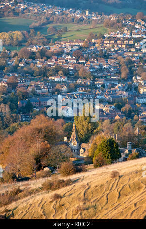 Clock tower in stanley park in Selsley village. View from selsley common across the stroud valley in autumn at sunset. Cotswolds, Gloucestershire, UK - Stock Photo
