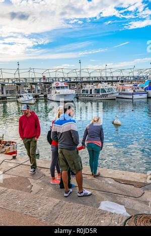 PUNTA DEL ESTE, URUGUAY, OCTOBER - 2018 - Group of people at port in punta del este city, Uruguay - Stock Photo