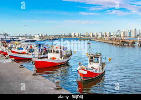 PUNTA DEL ESTE, URUGUAY, OCTOBER - 2018 - Old small fishing boats parked at port in punta del este city, Uruguay - Stock Photo