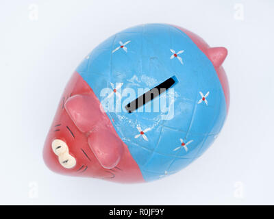 Colorful cute ceramic elephant piggy bank cut out isolated on white background