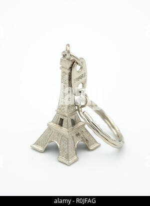 Miniature Eiffel Tower metallic key-chain Paris souvenir cut out isolated on white background - Stock Photo