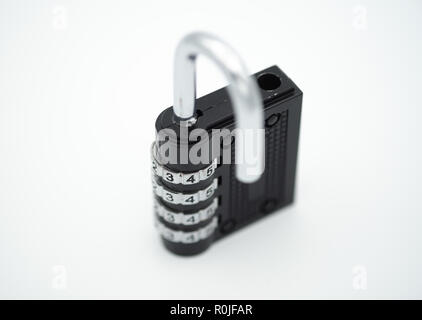 Black code number padlock open and isolated on white background - Stock Photo