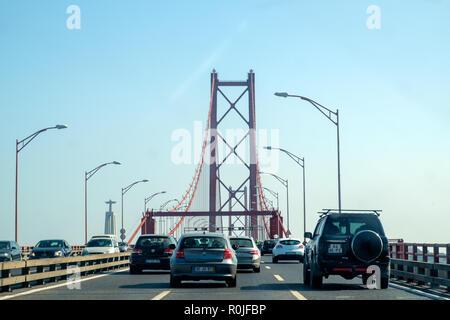 Cars crossing the Ponte 25 de Abril bridge over the Tejo river in Lisbon, Portugal, Europe - Stock Photo