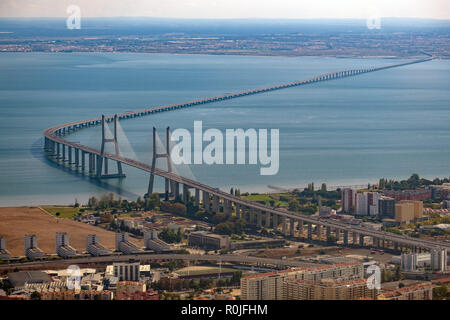 Aerial view of the Vasco da Gama bridge over the Tagus river in Lisbon, Portugal, Europe - Stock Photo