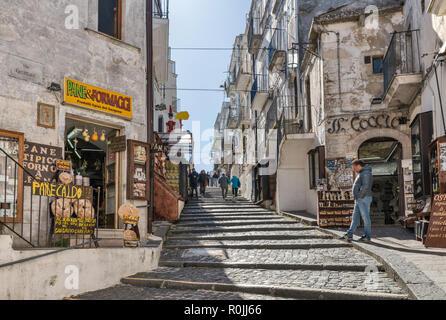 Via Castello, alley in town of Monte Sant'Angelo, Apulia, Italy - Stock Photo
