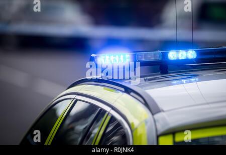 UK Police car lights flashing at a crime scene - Stock Photo