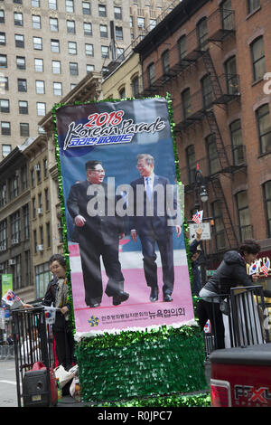 Korean Day Parade in New York City Passes through midtown Manhattan along 6th Avenue into Korea Town at West 32nd Street. National Communication Advisory Council promotes American & North & South Korean progress towards peace and Korean reunification. - Stock Photo