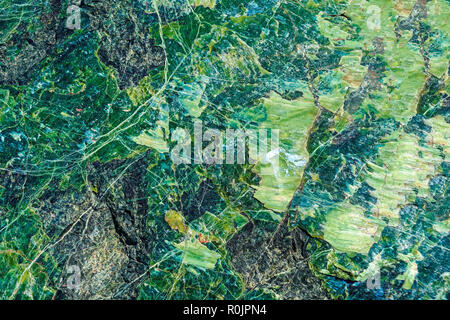 Close-up of macro shooting of natural mineral stone serpentine . Beautiful texture of the green stone. - Stock Photo