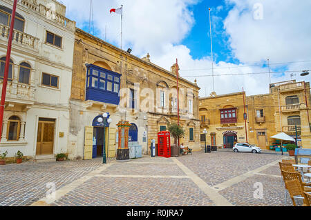NADUR, MALTA - JUNE 15, 2018: Historic mansions in Market square of the village, some of them are converted into cafes and stores, on June 15 in Nadur - Stock Photo