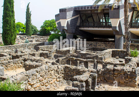 3 May 2018 The excavated ruins close to the first century Jewish Synagogue overlooked by a modern building in the ancient town of Capernaum in Israel - Stock Photo