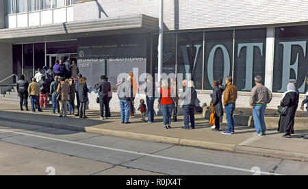A diverse line of voters wait to cast their ballots for the 2018 Midterm Elections at the Cuyahoga County Board of Elections in Cleveland, Ohio, USA. - Stock Photo