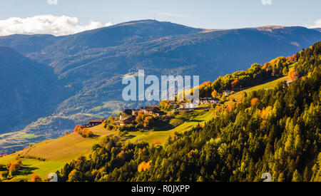 autumn landscape in Gardena Valley with a trees in autumn colors. Location National Park Dolomiti, South Tyrol, province of Bolzano, Italy, Europe - Stock Photo