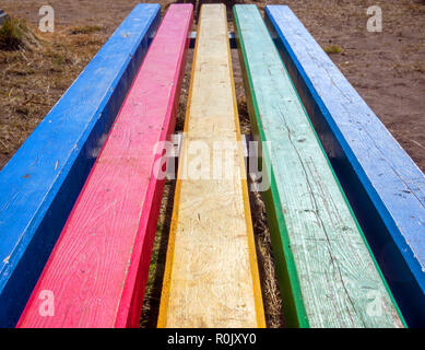 Street bench from multi-colored boards - Stock Photo