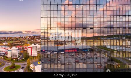 Reflections in modern glass tower, Kopavogur-suburb, Reykjavik, Iceland - Stock Photo