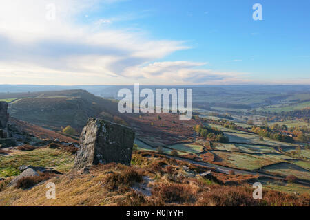 The early morning autumnal sun brightens the Derbyshire landscape. Viewed from high on Curnbar Edge in the Hope Valley. - Stock Photo