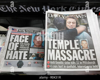 Front pages of New York newspapers on Sunday, October 28, 2018 report on the previous days shooting in the Tree of Life synagogue in Pittsburgh, PA allegedly by 46 year-old Robert Bowers which killed 11 at the religious services. Bower had a history of anti-semitic rantings on social media. (© Richard B. Levine) - Stock Photo