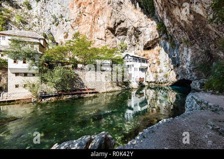 Blagaj Tekke, Dervish House, in rocks at Buna river, Bosnia And Herzegovina. - Stock Photo