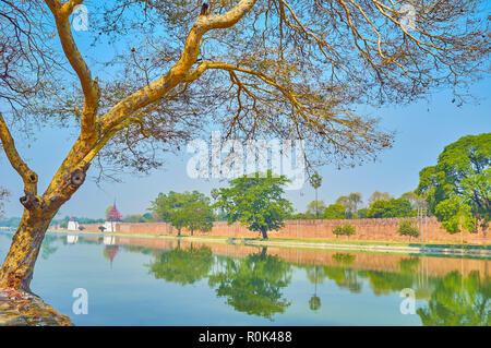 Mandalay city boasts lush greenery on the territory adjoining to the moat of the Royal Palace - Stock Photo
