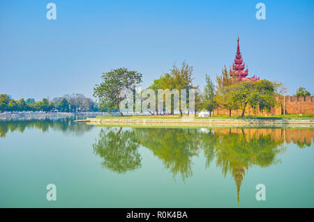 The Royal Palace with its surrounding moat are the most notable landmarks of the city, and one of the pleasant places for walk, Mandalay, Myanmar - Stock Photo