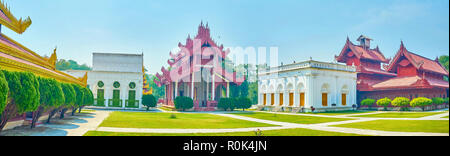 The panoramic view on the courtyard of the Royal Palace with beautiful different styled buildings, Mandalay, Myanmar - Stock Photo