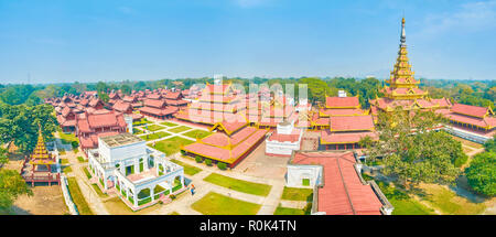 Panoramic view on Royal Palace in Mandalay with its beautiful oriental styled buildings and Golden Spire tower, Myanmar - Stock Photo