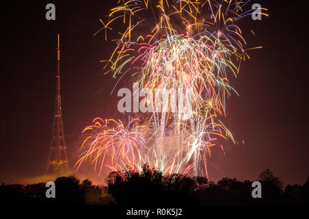 View of fireworks display, Crystal Palace park, and transmitting station (tv transmitter) on bonfire night, the 5th November, remembering Guy Fawkes - Stock Photo