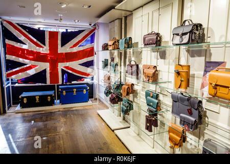 London England United Kingdom Great Britain Covent Garden Market market shopping dining entertainment The Cambridge Satchel Company shopping leather g - Stock Photo