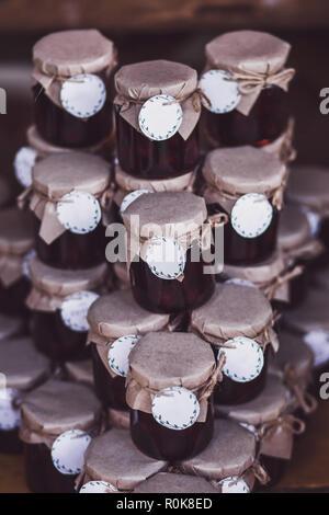 Set of handmade jars with jam on wedding - Stock Photo