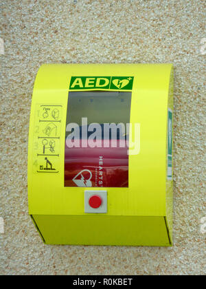 Defibrillator Medical Emergency Equipment Mounted on a n Outside Wall, UK - Stock Photo