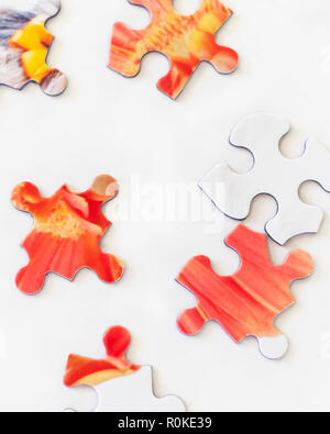 Puzzle pieces on white background. Representing solving problems, challenge, challenges, figuring out. - Stock Photo