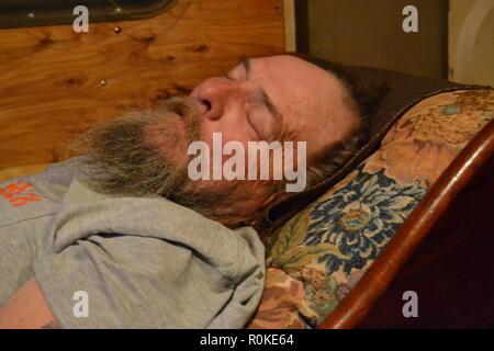Portrait of a man with a beard sleeping - Stock Photo