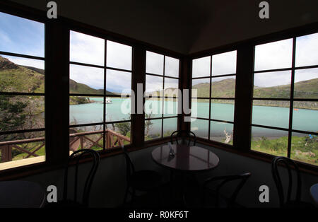 Looking out a cafe window at Lago Sarmiento, Torres del Paine National Park, Chile - Stock Photo
