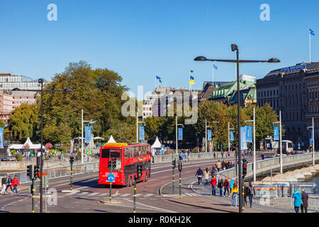 16 September 2018: Stockholm, Sweden - The city centre on a sunny Sunday in Autumn, with tourists, a sightseeing bus and the grand buildings of the... - Stock Photo