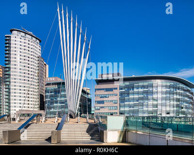 2 November 2018: Salford Quays, Manchester, UK -  BBC buildings, and the Media City Footbridge, which spans the Manchester Ship Canal, on a beautiful  - Stock Photo
