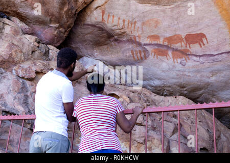 People looking at the Khoisan rock art in the Cederberg conservancy - Stock Photo