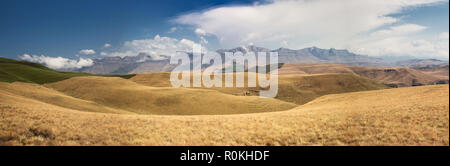 Panoramic landscape of the Drakensberg Mountain range - Stock Photo
