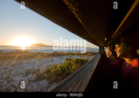 Couple bird watching in the West Coast National Park - Stock Photo