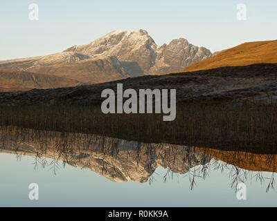 A still sunrise on the Isle of Skye. This was taken from the still waters of Loch Cill Chriosd looking to Blaven and its reflection - Stock Photo