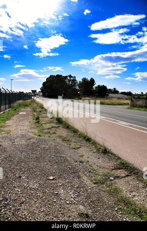 Lonely road under cloudy sky in Spain - Stock Photo