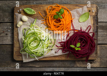Vegetable noodles - zucchini, carrot and beetroot - Stock Photo