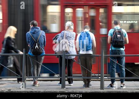 Belgrade, Serbia - October 16, 2018: People waiting at bus stop - Stock Photo