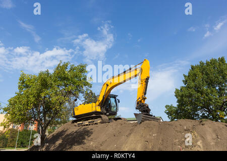 excavator against blue sky - Stock Photo