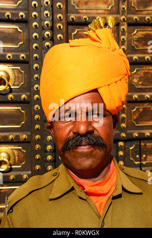 Guardian in front of the City Palace, portrait, Jaipur, Rajasthan, India - Stock Photo