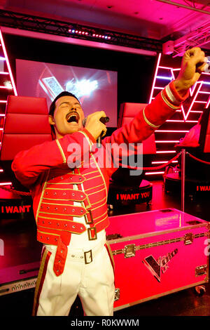 Wax figure of Freddie Mercury at world renowned tourist attraction Madame Tussauds Wax museum in London, United Kingdom. - Stock Photo