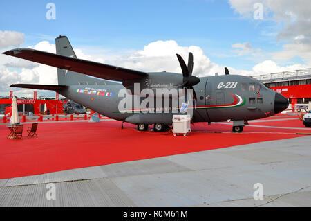 Alenia Aermacchi C-27J Spartan sales stand at the Farnborough International Airshow trade show. Finmeccanica trade area. Military transport plane - Stock Photo