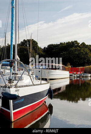 Boats on temporary moorings at Horsey Mere on the Norfolk Broads while the cut to Horsey Staithe is closed for a culvert repair. - Stock Photo