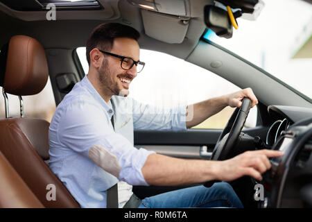 Man Using Gps Navigation System In Car to travel - Stock Photo