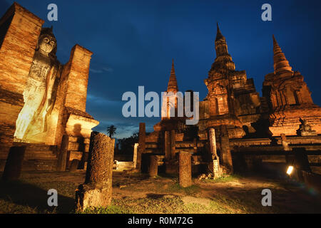 Ancient ruined Wat Mahathat in Sukhothai Historical Park, Sukhothai province, Thailand - Stock Photo