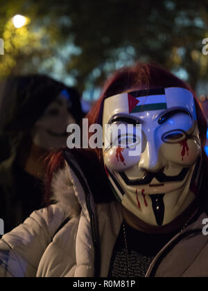 London, UK. 5th November 2018. One of the masks of the Protest march by Anonymous against austerity, mass surveillance, corrupt politicians. Anti-establishment protesters with Guy Fawkes masks, descending on Trafalgar Square and marching through London on Bonfire Night. Credit: Joe Kuis / Alamy Live News - Stock Photo